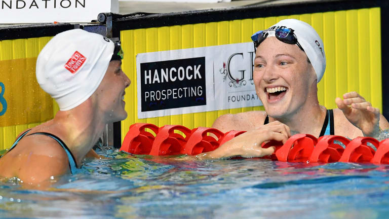 Cate Campbell (right) looks on to sister Bronte after winning the womens' 100m freestyle final.