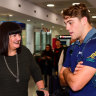 Rugby Australia boss Raelene Castle and Junior Wallabies Fraser McReight have a chat at Sydney Airport on Tuesday.