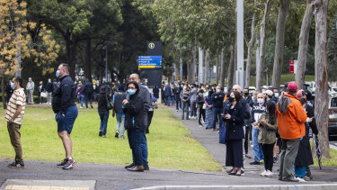 People queue to vaccinate at the NSW Vaccination Centre in Homebush.