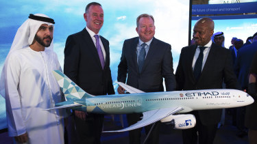 Etihad COO Mohammad al-Bulooki, left, Etihad CEO Tony Douglas, second left, Boeing Commercial Airplanes president and CEO Stanley A. Deal, third left, and Boeing Global Services President and CEO Ted Colbert.