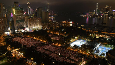 Thousands of people attend a Hong Kong candlelight vigil for victims of the Chinese government's brutal military crackdown in Beijing three decades ago.