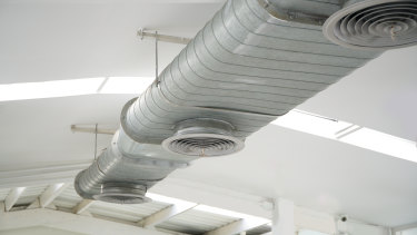 Research suggests office airconditioning systems should be running a few degrees warmer.
