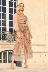 Beige, not boring ... Karlie Kloss at the Dior couture show in Paris on Monday.