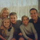 Family ties: Sarah and Lachlan Murdoch with their children Aerin, Kalan and Aidan.