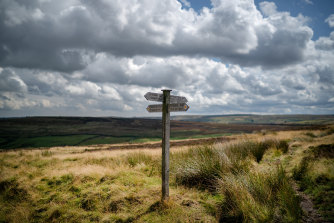 Sign posts direct walkers and Bronte fans across the North Yorkshire moors near Haworth, believed to be the setting for Emily Bronte's romantic novel 'Wuthering Heights'.