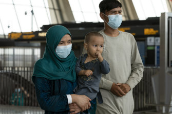 Families evacuated from Kabul, Afghanistan, after they arrived at Washington Dulles International Airport, in Chantilly, Virginia.