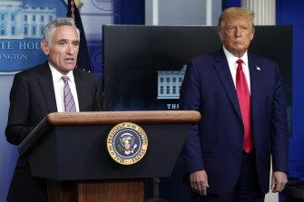 White House coronavirus adviser Dr Scott Atlas speaks as President Donald Trump listens during a news conference at the White House, in September.