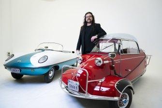Curator Damian McDonald with a 1950's Messerschmitt KR 200 and a 1950's Goggomobil Dart.