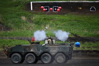 A soldier fires an anti-tank missile from a light-armoured vehicle during the Japan Ground Self-Defence Forces' annual live fire exercise in May.