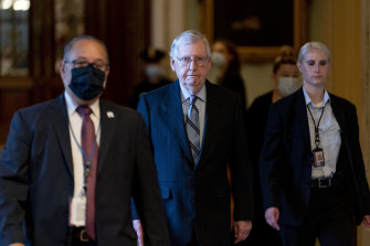 Senate Republican leader Mitch McConnell, centre, has stayed behind the scenes for much of the bipartisan work.