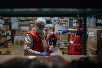 Red Cross volunteers at a food bank in Huesca, Spain have been helping people affected by the coronavirus.