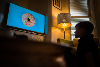 A child watches a new NHS ad on television that aims to promote healthy eating and exercise in lieu of junk food.