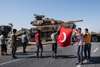 People show their support for the Turkish military near Ackakale as tanks move into Syria.
