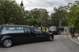 The couple and their unborn son were laid to rest in Brisbane on Monday.
