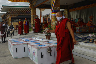 Monks perform a ritual as 500,000 doses of Moderna COVID-19 vaccine gifted from the United States arrived at Paro International Airport in Bhutan on July 12.
