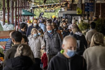 Shoppers with masks at South Melbourne Market - which has since been named as an exposure site - yesterday as Melbourne's COVID-19 restrictions continued.