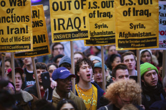 Protesters march in Times Square to oppose US action against Iran.