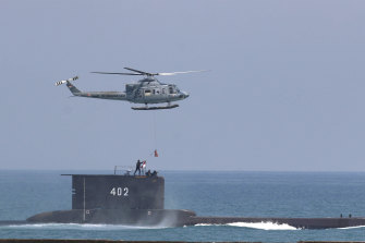 The KRI Nanggala-402 submarine - pictured during a naval drill in 2017 - is missing north of Bali.