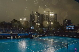 Heavy rain falls on Wednesday at Melbourne Park. Smoke and rain have affected qualifying.