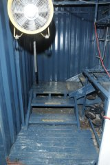 Inside the trapdoor, police walked down a set of sturdy stairs and into the three shipping containers where the cannabis was allegedly grown.