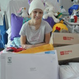 Tess Egginton in Perth Children's Hospital, surrounded by her Warrior Mail delivery.
