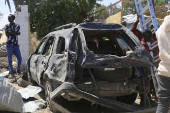 A view of a car destroyed during an attack at the Asasey Hotel in Kismayo, Somalia.