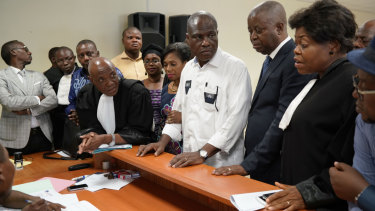 Accompanied by his wife and his lawyers, Congo opposition candidate Martin Fayulu, centre, petitions the constitutional court following his loss in the presidential elections in Kinshasa on Saturday.
