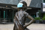 The Fearless Girl Statue in Federation Square donned a face mask during Melbourne's lockdown.