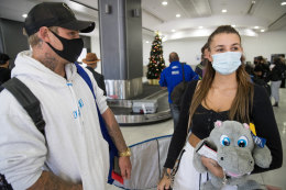 James Tomich and Stephanie Dugina arrived into Melbourne Airport on Saturday morning after spending time at the Gold Coast.