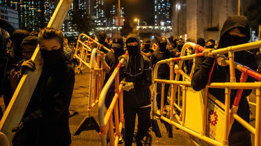 Protesters set up barricades in Tseung Kwan O, Hong Kong, after a ceremony paying tribute to (Alex) Chow Tsz-lok on Friday night.