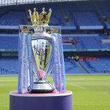 The English Premier League trophy sits in an empty stadium.