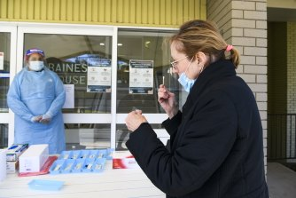 A staff member at the Whiddon Easton Park aged care facility in Sydney undergoes a rapid test during a trial.