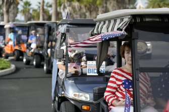A convoy of about 300 golf carts supporting Democratic presidential candidate Joe Biden heads to an early-voting post in The Villages.