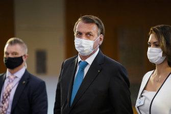 Brazil President Jair Bolsonaro leaves United Nations headquarters after his address.