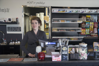 Margret Gudjonsdottir, 28, working alone at a roadstop in Hvammstangi, Iceland on April 30, as the country reopened.