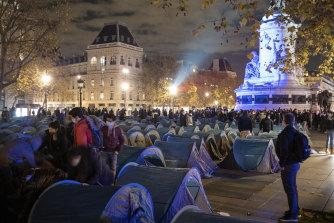 Migrants were tossed out of a makeshift camp on Place de la Republique in Paris on Monday night.