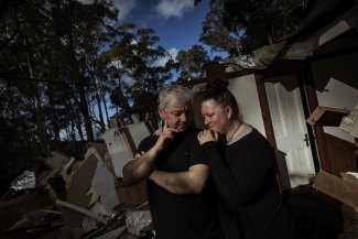 Lee and Nat Guest stand in the ruins of their home in Kalorama.