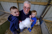 Chicken and egg situation: Hunter and Blair Vaughan are tutored by great-grandpa Alf Woods.