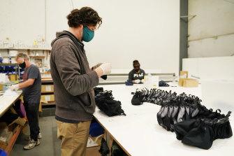 James Farren packs masks at his family's Carrum Downs factory.