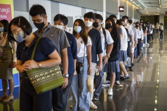 Thai job seekers wait in line at the Job Expo in Bangkok on Monday.