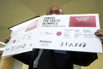 Lawyer Kenji Utsunomiya, a representative of an anti-Olympics group, displays the number of signatures on a petition to cancel the Tokyo Olympics and Paralympics, On Friday.