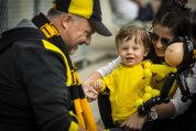 Tiger cub: Richmond fan Sarha Johnston and son Eddie, 14 months meet Brendon the Balloon Man at the VFL grand final.