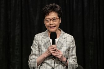 Hong Kong Chief Executive Carrie Lam addresses a packed stadium during her community dialogue session.