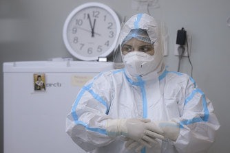 A member of the medical staff adjusts her gloves at the COVID-19 ICU unit of the Marius Nasta National Pneumology Institute in Bucharest, Romania.