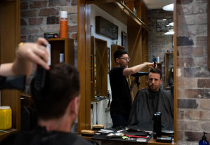 The Barber Shop's assistant manager Kaine Sinclair says the business was forced to shut for three weeks when its regular office worker clientele dried up.