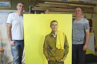 Ross Townsend (right) at his Gordon studio with the retired yellow Wiggle, Greg Page, and his portrait, in 2013.