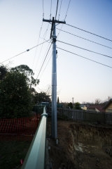 The power pole that became unstable after excavation commenced. A geotechnical assessment  has since found no safety issues although the concrete block remains.