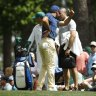 Day defies crippling back pain at Masters