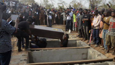 Volunteers handle coffins during a mass funeral for victims of attacks in  Nigeria earlier in January in a series of attacks blamed on Fulani herdsmen who oppose a new anti-grazing law.