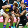 Collared: Bulldog Ed Richards is caught by Travis Boak.